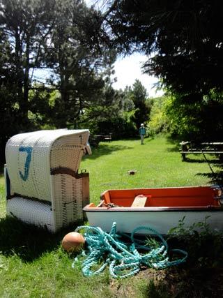 Haus Cap Horn: Strandkorb und Boot